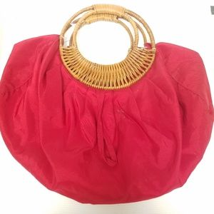 A Red Soft Bodied Purse with Bamboo Handle